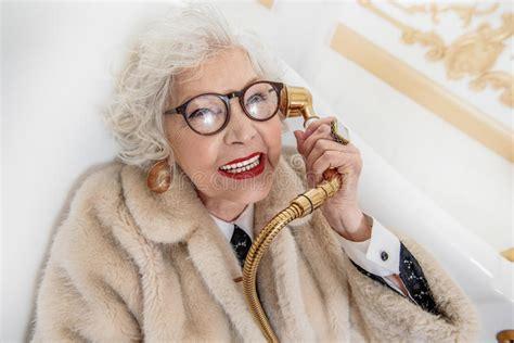 old woman fun wealthy old lady having fun in bathroom stock image