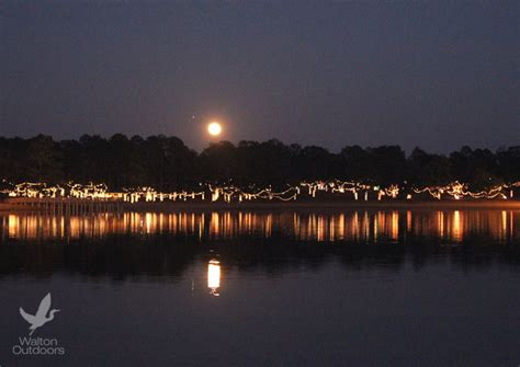 christmas reflections light up the lakeyard in defuniak