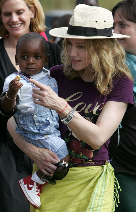 Madonna And Adopted David by Madonna And David And