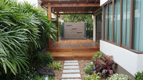 modern water wall raised teak deck family garden thai
