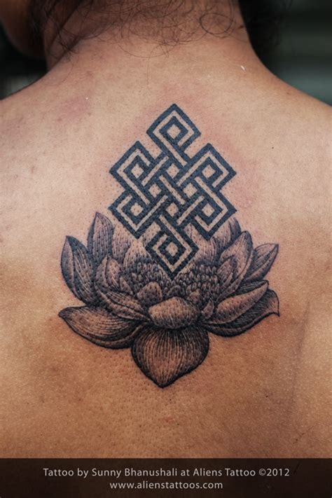 lotus knot tattoo buddhist knot on lotus tattoo inked by sunny at aliens