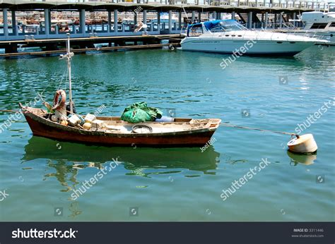 poor boat inequality poor fishing boat and luxury yachts punta del