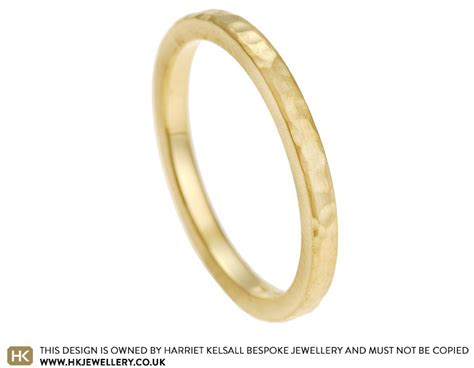hammered and satinised 18 carat yellow gold wedding band