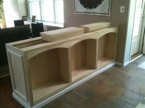half wall bookcase with columns built in halfwall