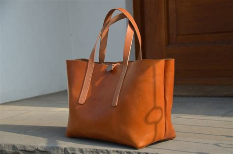 Leather Carrier Bag For The Who Has Everything by Cognac Be Cause Style Travel Collecting And Food