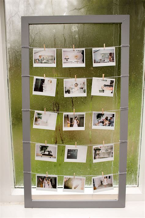 photo hanging ideas pegs wool and wood a d i y polaroid photo frame rock
