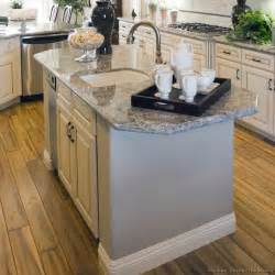 sink in kitchen island antique white kitchen with wood floors and an island sink