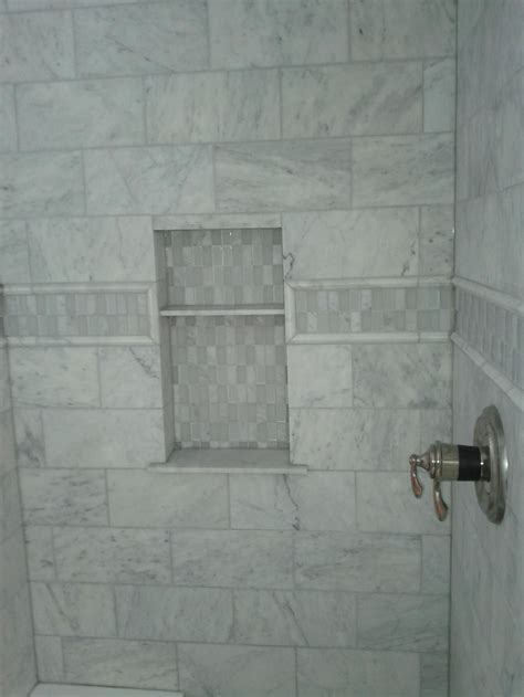 bathroom marble tile design idea with glass shelves tiles for this picture shows a marble tile shower with an accent
