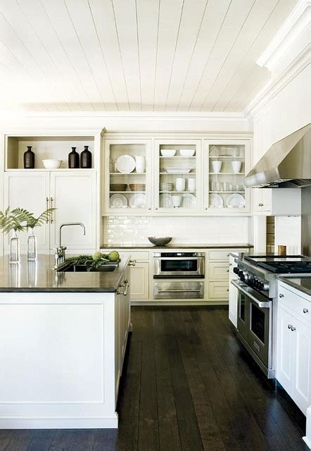 kitchens with white cabinets and dark floors dark wood floors white cabinets dark counters heavenly