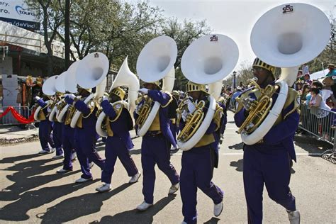 the tuba section of the st augustine high school purple
