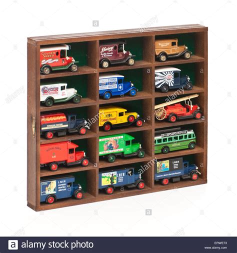 collection of vintage diecast model cars vans in display