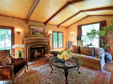 yellow living room with vaulted ceiling and old world