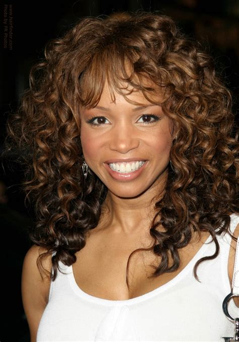long hair layered permed with bangs elise neal wearing her long hair with a spiral perm for curls