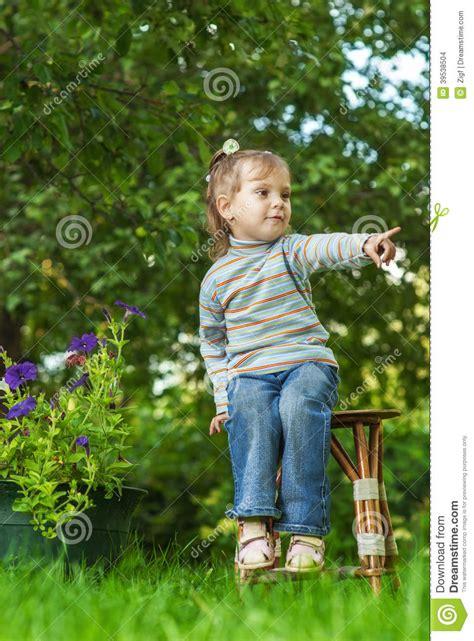 little girl sitting on bench statue sad little girl sitting on bench in the park stock image