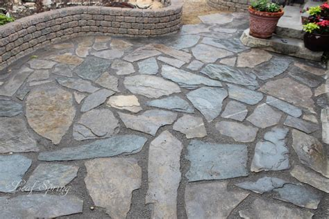 brown rundle rock patio with grey crushed limestone fill