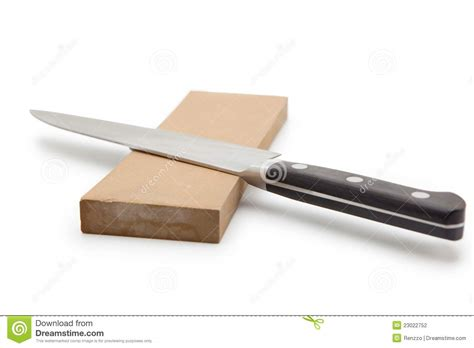 sharpening or water sharpening a knife on a waterstone stock photography