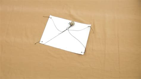 How To Make A Parachute Out Of Paper - 4 ways to make a parachute wikihow