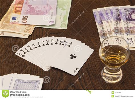 Gift Card Cash - vintage still life of playing cards cash money and shot of alc editorial stock image