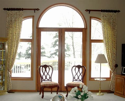 Front Door Windows Inspiration Stylish Clear Glass Swing Front Door Ideas With Amazing Arched Windows Trim Also Bronze