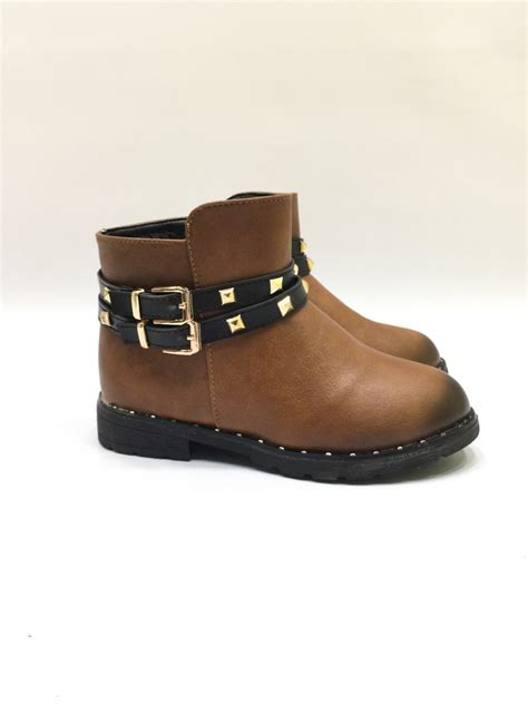 brown ankle boots with black belts and studs