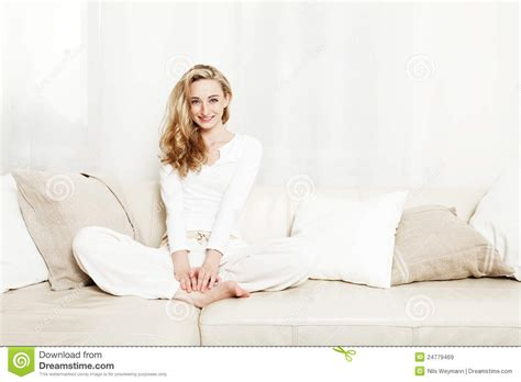 woman on couch beautiful woman sitting on couch royalty free stock images
