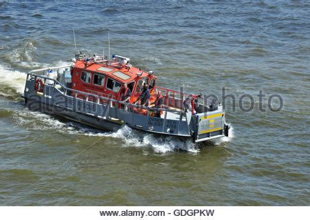 river thames boat fire fire rescue boat on the river thames stock photo royalty