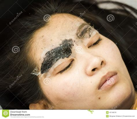 makeup eyebrow tattooing pretty asian woman face stock