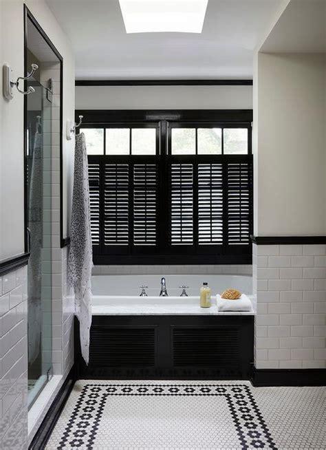 glossy black niche shelves  bathtub traditional