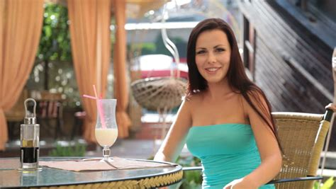 beautiful mail beautiful young woman in restaurant with a glass of