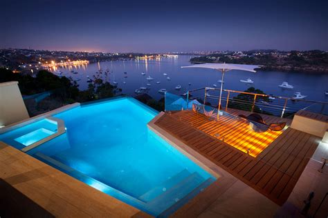 stunning house with pool and view evening pool lighting water views stunning riverside