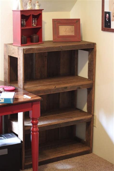 how to make pallet bookshelves 13 budget friendly diy pallet shelves and racks shelterness