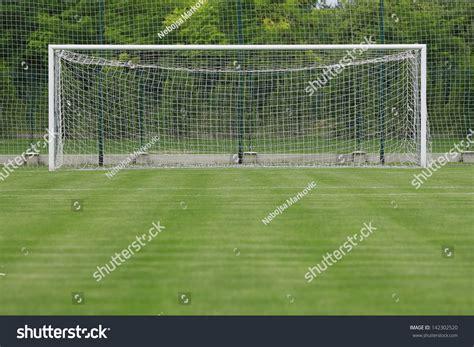 Soccer Goal White soccer field grass goal stadium soccer stock photo