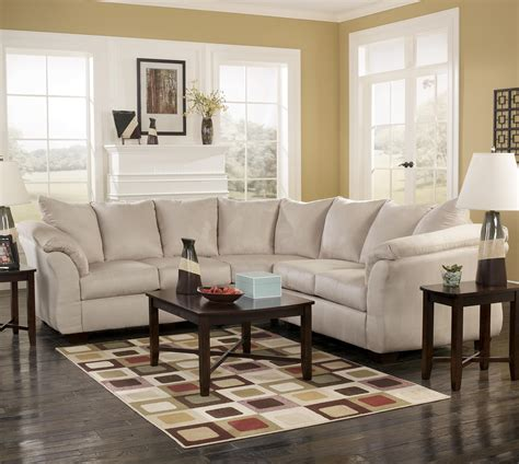 marlo living room furniture signature design darcy contemporary sectional sofa with sweeping pillow arms
