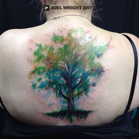 watercolor tattoo upper back silhouette tree on back