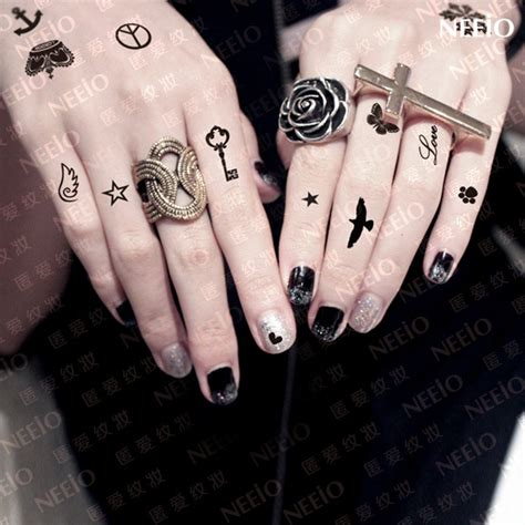 hand tattoo reviews temporary tattoos crown heart skull sun star snowflake