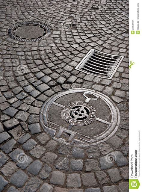 Lighthouse House Plans cast iron drain cover royalty free stock photography