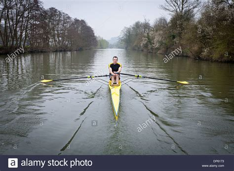 single scull boat buy one man in a single scull rowing boat on the river avon in