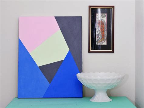 make modern geometric wall art with paint and tape hgtv