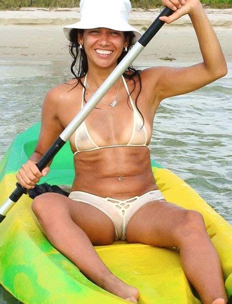women in see through bikinis tikini beach bar girl kayaking in a see through bikini
