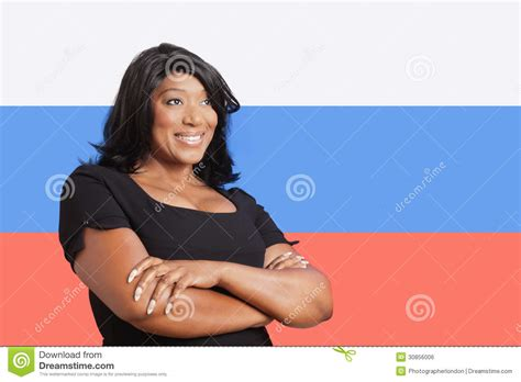 mixed russians thoughtful casual mixed race woman over russian flag