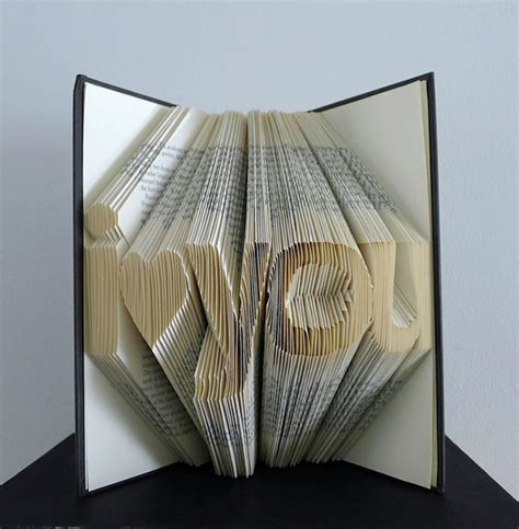 Folding Paper Book - beautiful typographic book sculptures created with folded