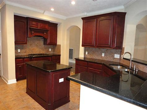 awesome kitchen island black granite with cherry paint color also recessed panel cabinet doors
