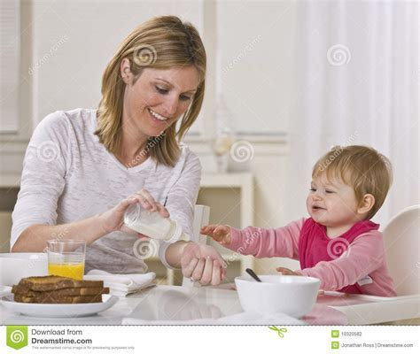 Mom And Baby Eating Breakfast Stock Photography   Image