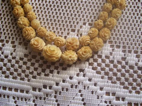 100   YEAR OLD CARVED ELEPHANT IVORY (CHINESE) GRADUATED ROSES, NECKLACE VERY YELLOWED