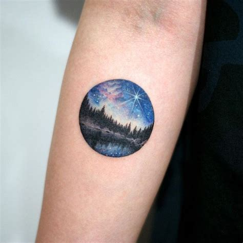 small badass tattoos sky galaxy forest lake circle small
