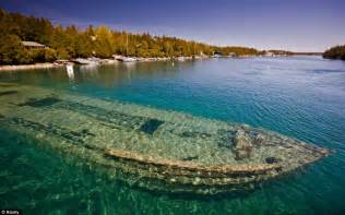 clearest water in the world world 191 s most beautiful shipwreck haunting hull of sweepstakes lies just twenty feet below clear