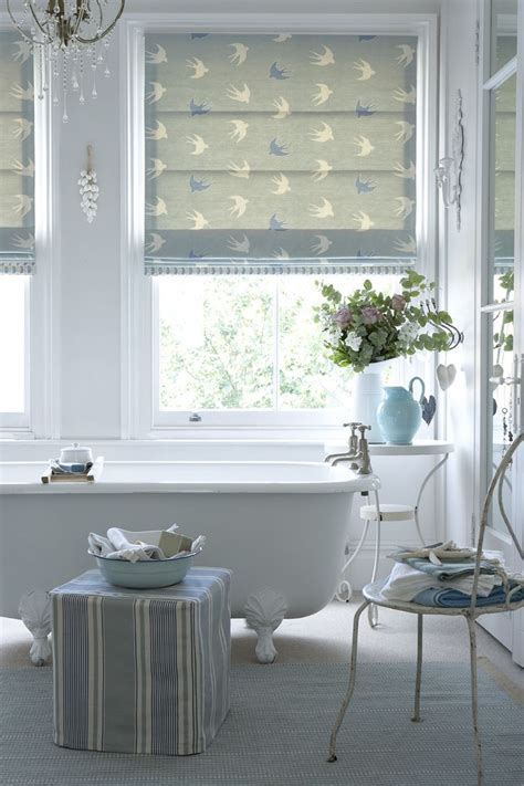 Roman blind in swallow e duck egg and speedwell with a leading edge in little leaf forget