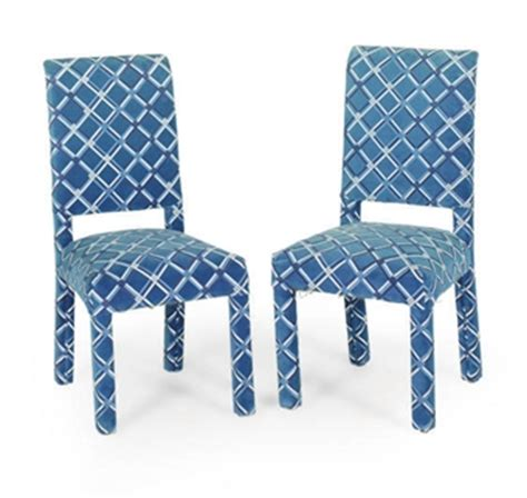 a set of six blue and white upholstered dining chairs