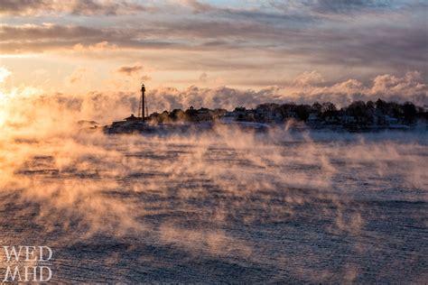 sea smoke tendrils of sea smoke at sunrise marblehead ma