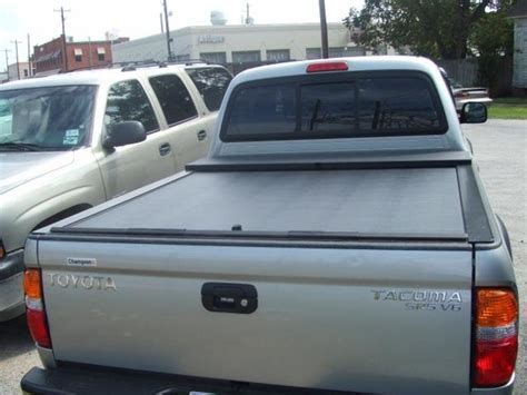 locking truck bed covers roll n lock retractable truck bed cover 01 04 tacoma